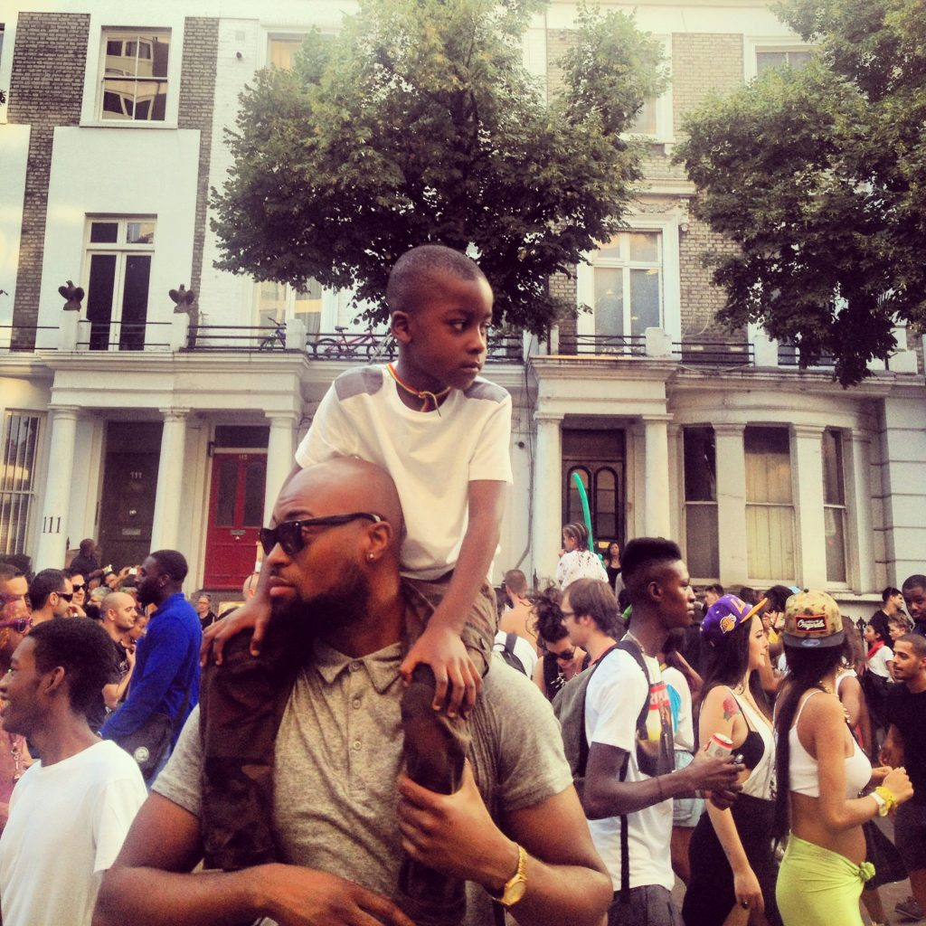 Anthony Dziworshie with his son on his shoulders in support of his thoughts on equal representation in this article.